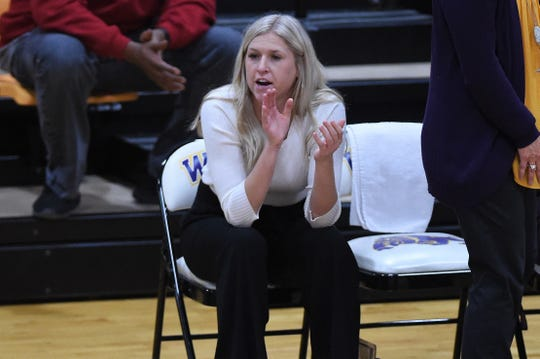 Wylie assistant coach Peyton Little gives instructions from the bench against Wolfforth Frenship at Bulldog Gym on Tuesday, Nov. 12, 2019. The Lady Bulldogs fell 61-42.