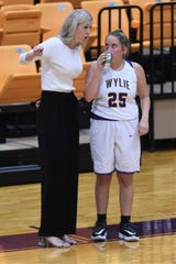 Wylie assistant coach Peyton Little talks to Makinlee Bacon (25) coming out of halftime against Wolfforth Frenship at Bulldog Gym on Tuesday, Nov. 12, 2019. The Lady Bulldogs fell 61-42.