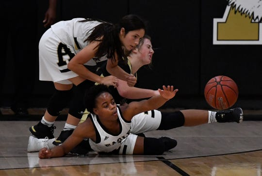 Abilene High's Toria Wilson reaches for the ball after getting tangled with teammate Leila Musquiz wrestling over the ball with Clyde's Brynn Burson during Tuesday's game at Abilene High Nov. 12, 2019.
