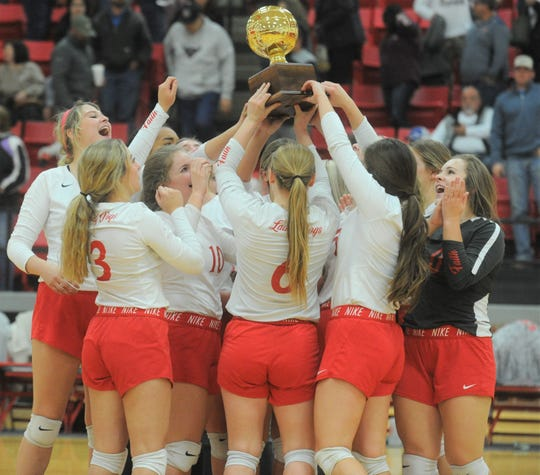 The Miles volleyball team holds up its trophy following a win over De Leon in a Region I-2A quarterfinal match Tuesday, Nov. 12, 2019, at Eastland High School's Marshall Gym.