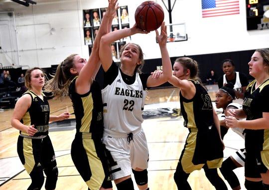 Clyde's Liz Underwood (left) and Averi Berry try to block the shot of Abilene High's Kelly Boyland during Tuesday's basketball game at Abilene High Nov. 12, 2019.