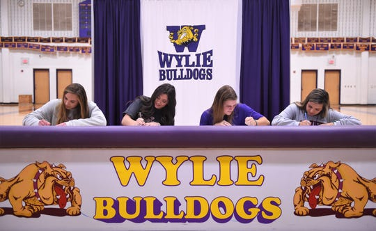 Four Wylie athletes signed to continue their careers in college in Bulldog Gym on Wednesday, Nov. 13, 2019. Pictured (L-R): Maddi Olson (SMU golf), Keetyn Davis (Midwestern State volleyball). Kaylee Philipp (ACU softball) and Kalli Hanson (McMurry soccer).