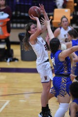 Wylie's Kenyah Maroney (32) takes a shot against Wolfforth Frenship at Bulldog Gym on Tuesday, Nov. 12, 2019. The Lady Bulldogs fell 61-42.