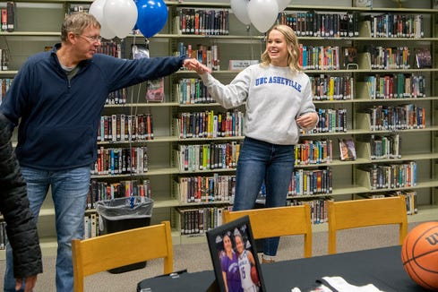 North Buncombe senior Lani Woods says goodbye to her select travel team coach Joe Carrington after signing her letter of intent to play college basketball at UNC Asheville during a ceremony at North Buncombe High School on Nov. 13, 2019. Woods also played for Carrington at Carolina Day School before the basketball team was eliminated and she had to transfer schools to continue to play.