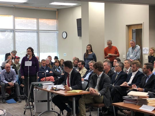 Kate Millar, incoming president of the Malvern Hills Neighborhood Association, testifies at the Buncombe County Board of Adjustment hearing on Nov. 13. The board agreed to postpone a hearing on the controversial Crossroads at West Asheville project until its Dec. 11 meeting.