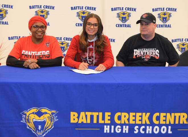 Battle Creek Central's Kandis Orns signs to play college soccer at Davenport University. She is joined by her parents, Beatrice and Andrew Orns.