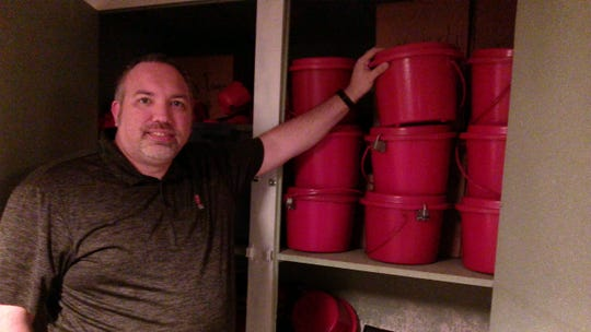 In a basement storeroom, Capt. Joseph Hansen, corps officer for the Salvation Army, Binghamton Center for Worship and Service, with kettles used during the fundraising campaign.