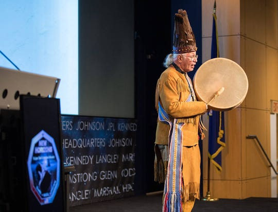 "Reverend Nick Miles, Tecumseh Red Cloud, Pamunkey Tribe, performs a traditional Algonquian chant of ""Thank you, O Great Spirit,"" at a naming ceremony for 2014 MU69, a celestial body discovered by the New Horizons mission and Hubble Space Telescope, formerly nicknamed ""Ultima Thule"", Tuesday, Nov. 12, 2019, at NASA Headquarters in Washington. The new name, ""Arrokoth,"" means ""sky"" and is from the Algonquian Languages, spoken by the Powhatan tribes of the region of Maryland it was discovered in. Tribal elders from those tribes approved of the name and participated in the ceremony.  Photo Credit: (NASA/Aubrey Gemignani)"