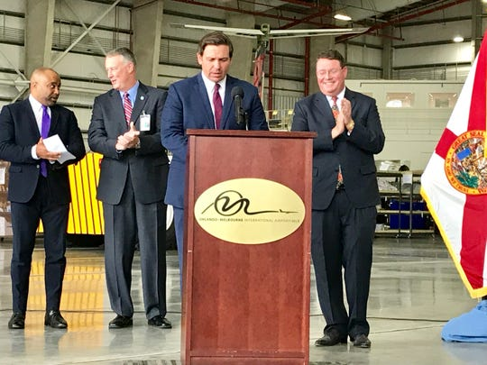 Gov. Ron DeSantis announces the state grant flanked by (left to right) Florida Department of Economic Opportunity Executive Director Ken Lawson, Orlando Melbourne International Airport Executive Director Greg Donovan and Florida Rep. Randy Fine.