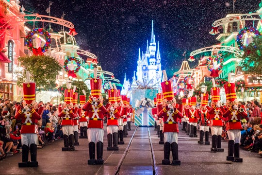 "Toy soldiers parade down Main Street, U.S.A., at Magic Kingdom during ""Mickey's Once Upon a Christmastime Parade."""