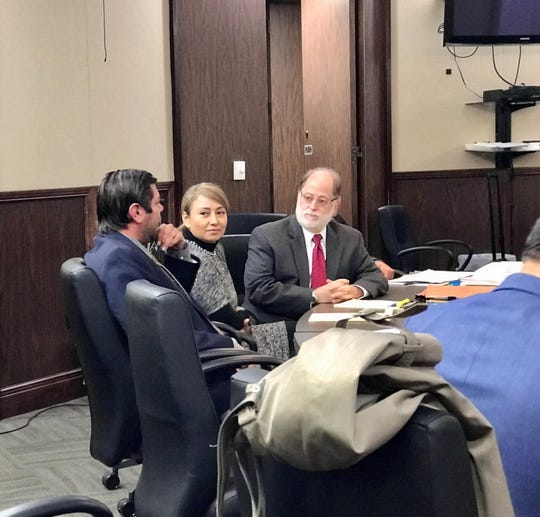 Norma Deleon sits with her lawyers before the start of her trial on Wednesday, Nov. 13, 2019. The former Corpus Christi police senior officer is accused of pretending to be a state Child Protective Services worker.