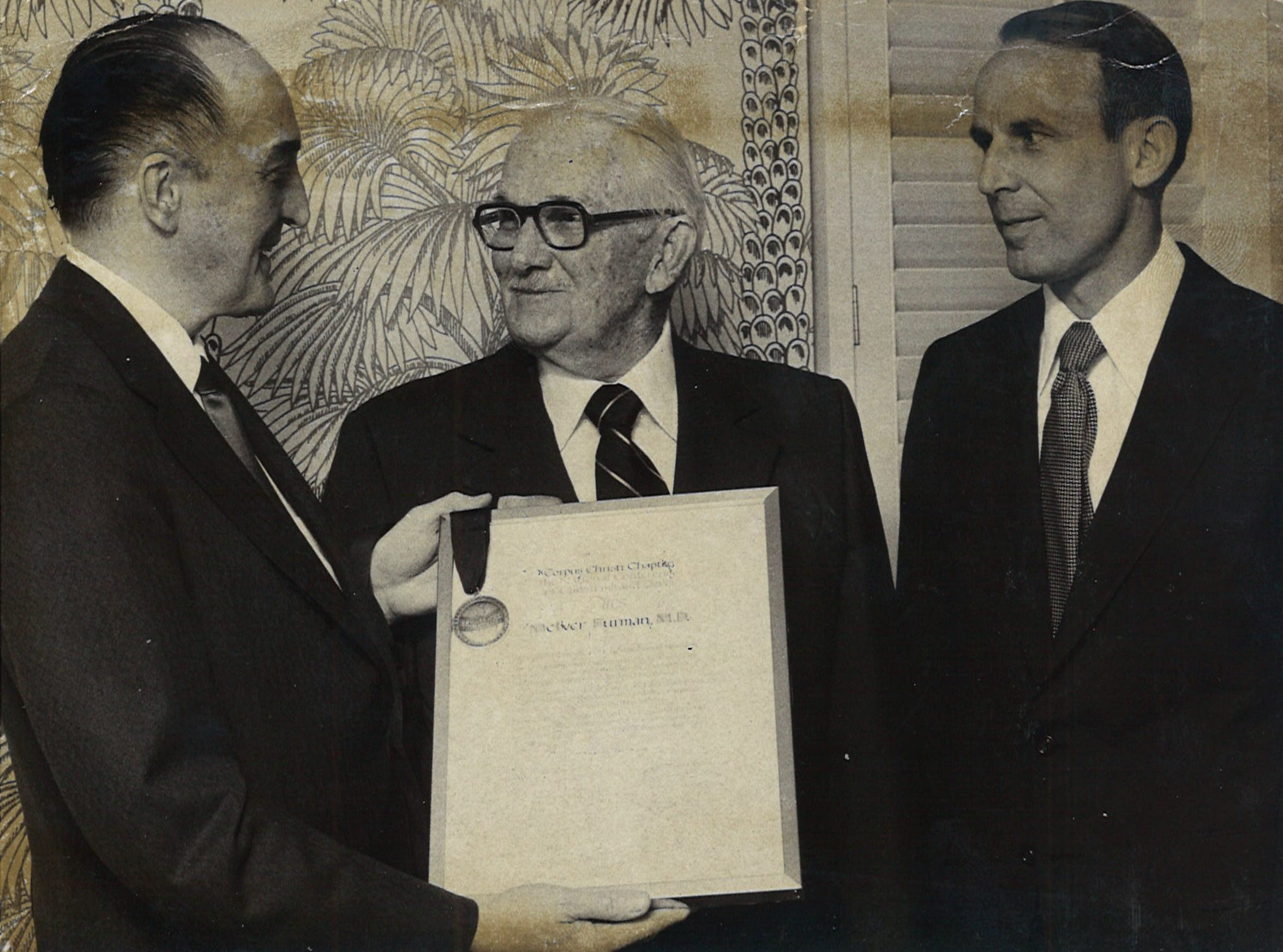 Dr. McIver Furman (center) received the Brotherhood Aware from the National Conference of Christians and Jews on April 5, 1973. Presentinf the award was Dr. David Hyatt (left) and F. Starr Pope Jr. (right).