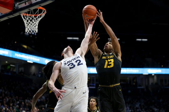 Xavier Musketeers forward Zach Freemantle (32) goes up for a rebound against Missouri Tigers guard Mark Smith (13) in the first first half of a college basketball game, Tuesday, Nov. 12, 2019, at Cintas Center in Cincinnati.