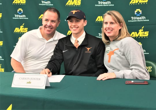 Sycamore senior Carson Foster signs to swim for the University of Texas, with parents James and Michelle Foster, November 13, 2019