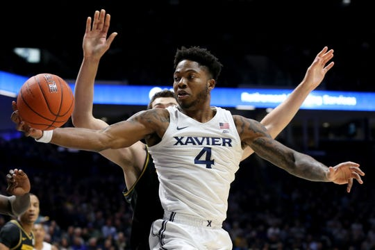 Xavier Musketeers forward Tyrique Jones (4) rebounds the ball in the first half of a college basketball game, Tuesday, Nov. 12, 2019, at Cintas Center in Cincinnati.