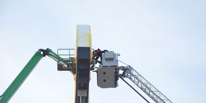 A man was rescued from the top of a McDonald's sign in Middletown.