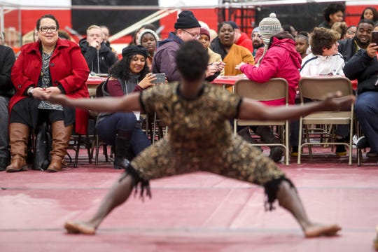 Attendees watch as the Zuzu African Acrobats perform the limbo at the 29th annual International Night at Austin Peay State University in Clarksville, Tenn., on Tuesday, Nov. 12, 2019. | henrytaylor@theleafchronicle.com