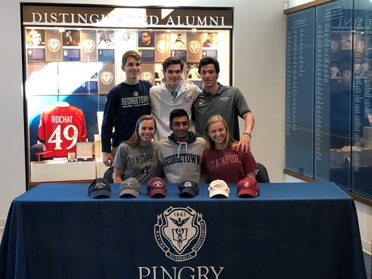 Back row left to right: Pingry's Derek Raskopf, Will Bugliari, Kalman Kram. Front row left to right: Caroline Dannenbaum, Pranav Jha and Emma Capanna sign their National Letters of Intent on Wednesday, Nov. 13, 2019.