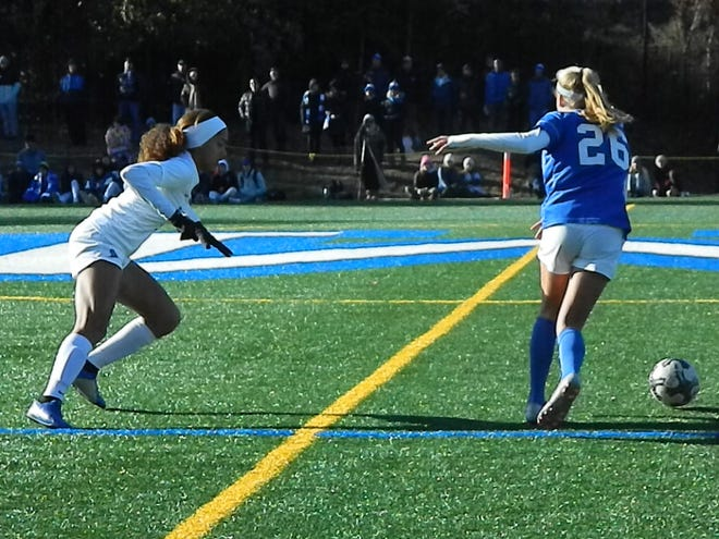 Scotch Plains-Fanwood's Corinne Lyght (left) and Montclair's Chloe Nemes (26) vie for the ball during the NJSIAA Group IV semifinals on Wednesday, Nov. 13, 2019.