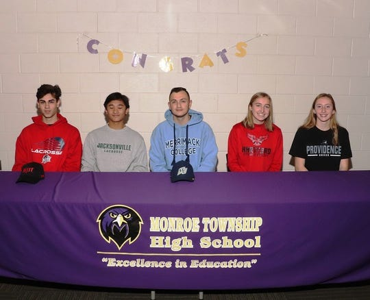Monroe's (from left to right): Mason Grossman, Josh Estavillo, Bryant Skurbe, Sarah Kulpa,  Emma Bodmer sign their National Letters of Intent on Wednesday, Nov. 13, 2019.