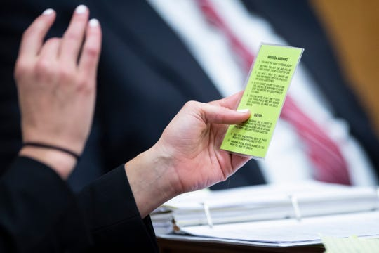 Jennifer Frese, defense attorney for Cristhian Bahena Rivera, holds up a Miranda card during an evidence suppression hearing at the Poweshiek County Courthouse on Wednesday, Nov. 13, 2019 in Montezuma. Bahena Rivera confessed to killing Molly Tibbetts last year but his attorneys filed a motion to suppress the confession because he was not properly read his Miranda warning during initial interviews with police.