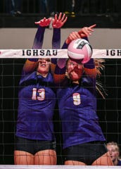 Nevada's Sydney Mosinski (13) and Kacie Rewerts (9) jump to make a block during their Class 3A quarterfinal match of the girls high school state volleyball tournament at the U.S. Cellular Center in Cedar Rapids on Wednesday, Nov. 13, 2019.