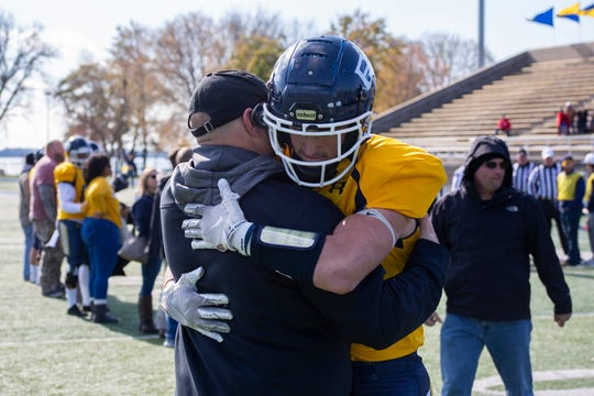 Jordan Travis hugs Buena Vista coach Grant Mollring during Senior Day introductions on Nov. 2 in Storm Lake.