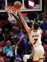 Miami Heat guard Goran Dragic shoots over Detroit Pistons forward Thon Maker during the first half Tuesday, Nov. 12, 2019, in Miami.
