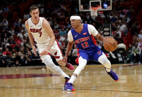 Detroit Pistons guard Tim Frazier drives as Miami Heat guard Goran Dragic defends during the first half Tuesday, Nov. 12, 2019, in Miami.