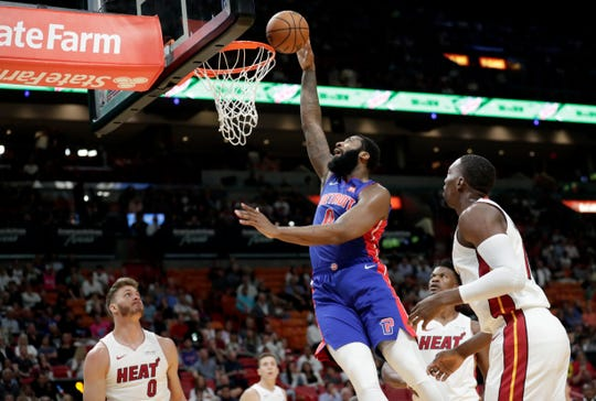 Andre Drummond shoots between Heat center Meyers Leonard, left, and forward Bam Adebayo, right, during the first half Tuesday in Miami.