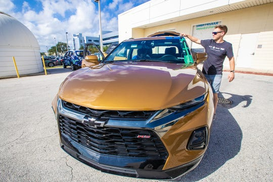 Embry-Riddle student Alex Shiffer, runs some temporary electrical wiring before taking the EcoCar 4 out for initial road testing outside the Green Garage at  Embry-Riddle Aeronautical's, College of Engineering, on Daytona Beach Campus, October 25, 2019.  The EcoCar4 team will convert the AWD Chevy Blazer into a hybrid.