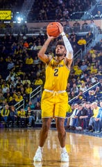 Michigan forward Isaiah Livers makes a 3-pointer in the second half against Creighton at Crisler Center in Ann Arbor, Tuesday, Nov. 12, 2019.