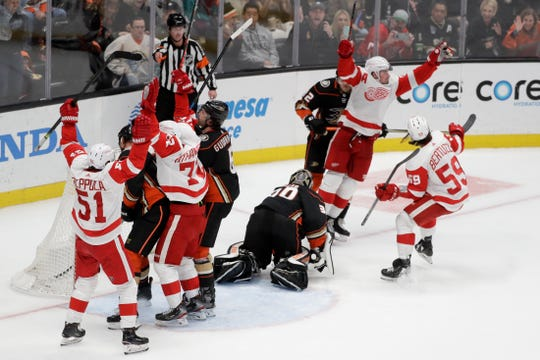 Red Wings center Dylan Larkin (71) celebrates after scoring the game-tying goal pass Ducks goaltender Ryan Miller during the third period of the Wings' 4-3 win on Tuesday, Nov. 12, 2019, in Anaheim, California.
