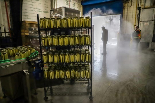 Cold air mingles with the steam from the pasteurization machines as the bay doors are opened for delivery at McClure's Pickles plant in Detroit on Wednesday, Nov. 13, 2019.
