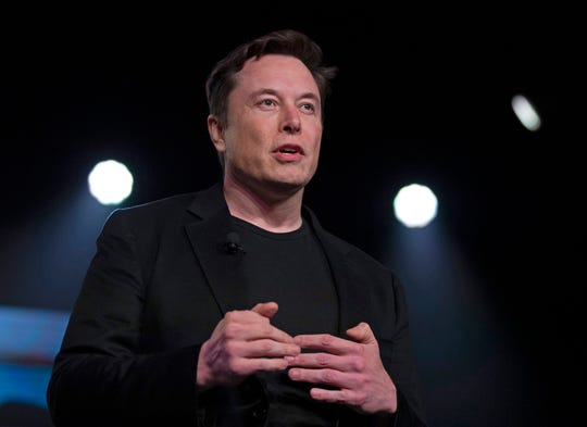 FILE- In this March 14, 2019, file photo Tesla CEO Elon Musk speaks before unveiling the Model Y at Tesla's design studio in Hawthorne, Calif. Tesla CEO Elon Musk says the electric car pioneer plans to build a new factory near Berlin.