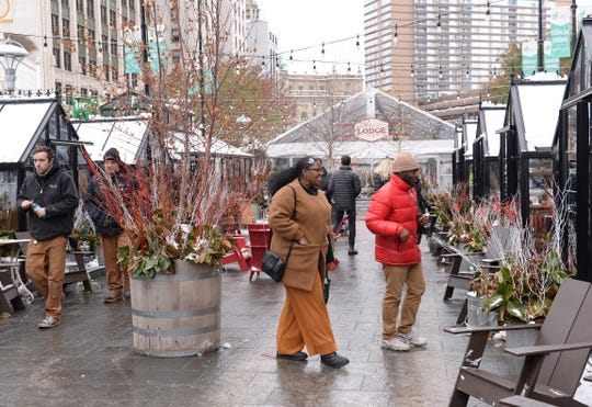 People browse the vendors at the Downtown Detroit Markets at Cadillac Place Wednesday afternoon.