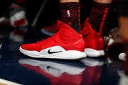 Portland Trail Blazers forward Zach Collins (33) wears a pair of Nike Hyperdunks in the first half of an NBA basketball game in Denver.