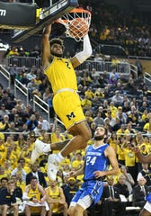 Michigan forward Isaiah Livers (2) dunks in the second half.