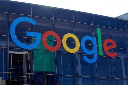 In this Sept. 24, 2019, file photo a sign is shown on a Google building at their campus in Mountain View, Calif. Google plans offer checking accounts run by Citigroup and a credit union, according to a report by The Wall Street Journal.