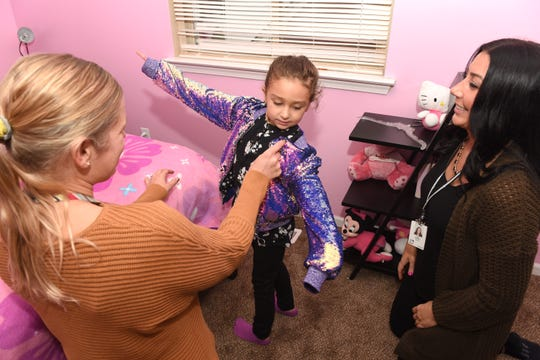 Oakman Elementary School teachers Michelle Rawson,left, and Lisa Younce enjoy spending after school time with Oakman Elementary School student Selena Saghir as they enjoy the glitter of a special jacket during the Parent Teacher Home Visit Project Tuesday, October 29, 2019.