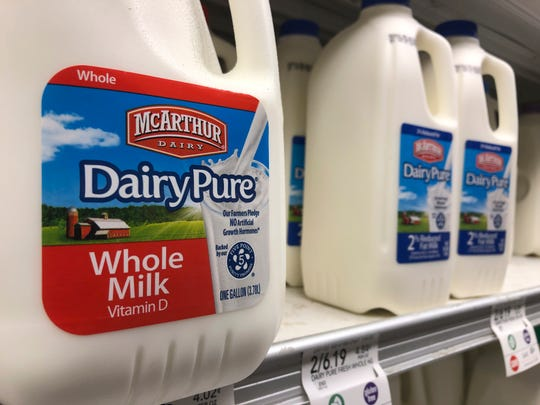 Jugs of McArthur Dairy milk, a Dean Foods brand, are shown at a grocery store, Tuesday, Nov. 12, 2019, in Surfside, Fla.