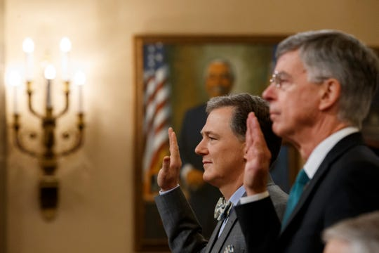 Top U.S. diplomat in Ukraine William Taylor, right, and career Foreign Service officer George Kent, left are sworn in to testify before the House Intelligence Committee on Capitol Hill in Washington, Wednesday, Nov. 13, 2019, during the first public impeachment hearing of President Donald Trump's efforts to tie U.S. aid for Ukraine to investigations of his political opponents.