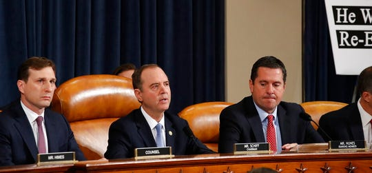 House Intelligence Committee Chairman Rep. Adam Schiff, D-Calif., center, gives his opening statement as ranking member Rep. Devin Nunes, R-Calif., right, looks on during a hearing of the House Intelligence Committee on Capitol Hill in Washington, Wednesday, Nov. 13, 2019.