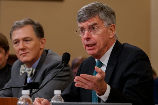 Career Foreign Service officer George Kent, left, listens as top U.S. diplomat in Ukraine William Taylor, right, testifies before the House Intelligence Committee on Capitol Hill in Washington, Wednesday, Nov. 13, 2019, during the first public impeachment hearing of President Donald Trump's efforts to tie U.S. aid for Ukraine to investigations of his political opponents.