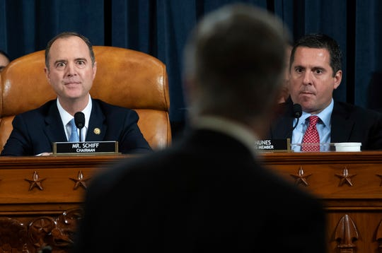 House Intelligence Committee Chairman Rep. Adam Schiff, D-Calif., left, and ranking member Rep. Devin Nunes, R-Calif., watch as Top U.S. diplomat in Ukraine William Taylor leaves after testifying at a hearing of the House Intelligence Committee.