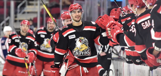 Joe Veleno celebrates his game-winning goal against the Monsters on Tuesday.