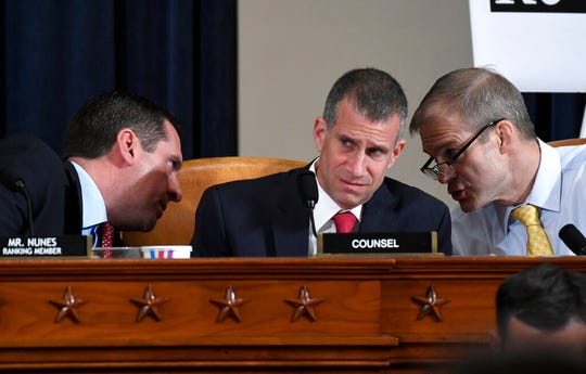 Ranking member Rep. Devin Nunes, R-Calif., talks to Rep. Jim Jordan, R-Ohio, right, as Steve Castor, Republican staff attorney for the House Oversight Committee, center, listens during the House Intelligence Committee on Capitol Hill in Washington, Wednesday, Nov. 13, 2019.