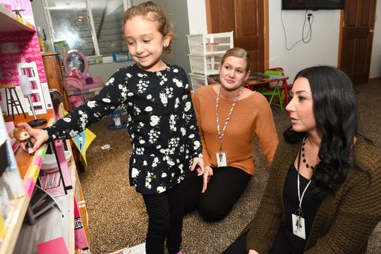 Oakman Elementary School student Selena Saghir, left, plays with her barbie townhouse with Oakman Elementary School teachers Michelle Rawson and Lisa Younce during the Parent Teacher Home Visit Project Tuesday, October 29, 2019.