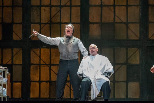 "Stephen Powell (left with razor), the demon barber of Fleet Street prepares to shave Ron Raines in ""Sweeney Todd"" at MOT."