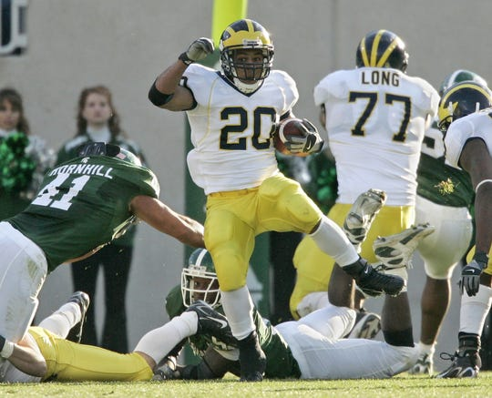 Mike Hart runs against Michigan State in the 2007 game.